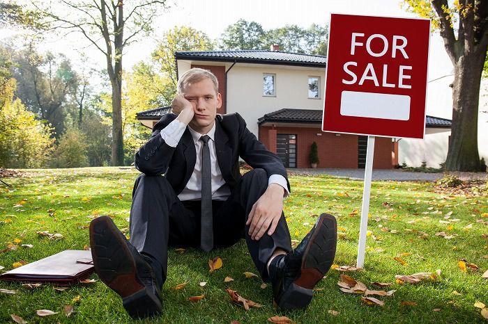 土地を売却中の人物